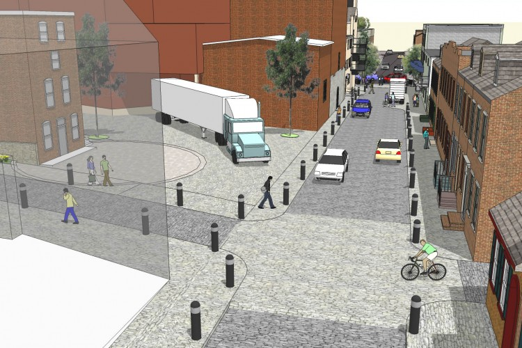 "Water Street: Future – ""Shared Space"" – One block of a tiny antique street could  be relieved with several design  changes to become more walkable and safer for pedestrians, better for businesses and customers, easier and safer for cycling, and a quieter, more appealing place  to live and work."