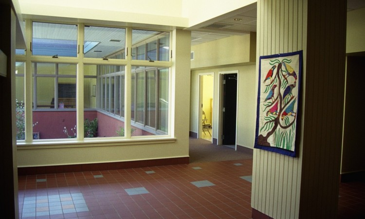 Entry lobby interior. Careful design work carved out a usable social  space right at the intersection of the 1871 church building and the new classroom wing, which extends on the right.