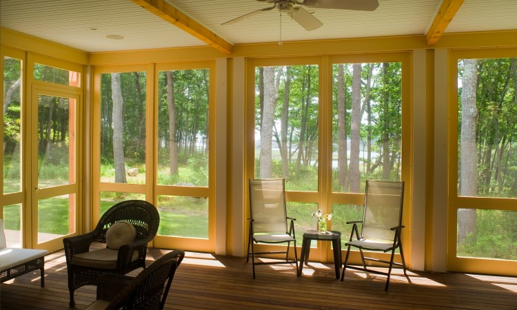 A 16' by 24' screened porch is large enough for group dining and  indoor game-playing