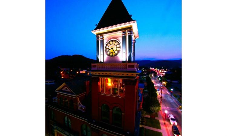 Corner clocktower restored and newly-illuminated following our lighting design work.
