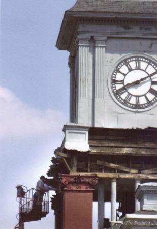 Structural repair work in progress beneath tower clock enclosure.