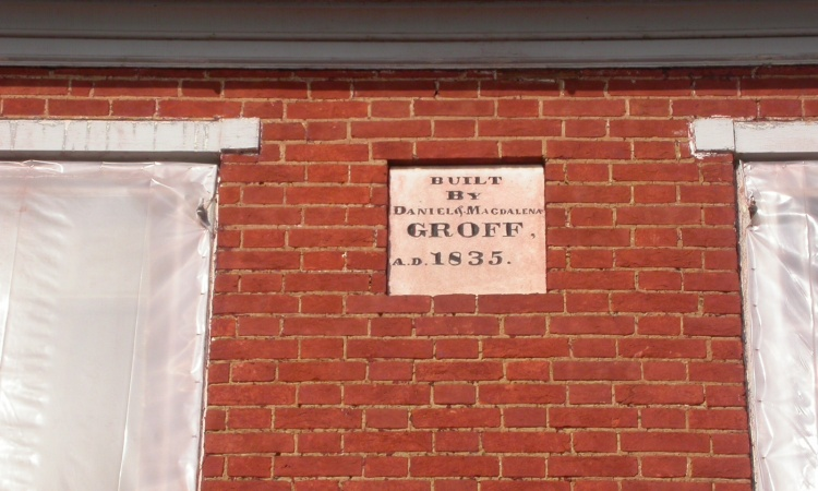 Though other brickwork had been altered, the original datestone remained in place.